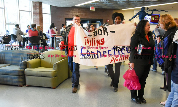 042517 Wesley Bunnell | Staff Facing budget cuts from the State of CT students and faculty organized a protest against CSCU's President Mark Ojakian's budget proposal which they fear would weaken the CCSU campus. Protestors walk through the CCSU Dining Hall on their way from Welte Hall to the student center.