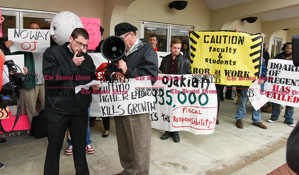 042517 Wesley Bunnell | Staff Facing budget cuts from the State of CT students and faculty organized a protest against CSCU's President Mark Ojakian's budget proposal which they fear would weaken the CCSU campus. Students and faculty hold signs during the rally as student Joseph Luchene , second from left, speaks.
