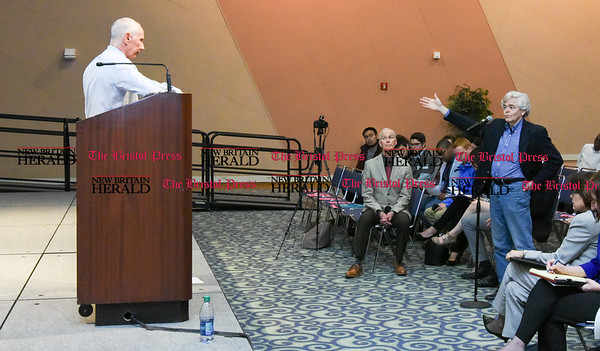 042517 Wesley Bunnell | Staff Facing budget cuts from the State of CT students and faculty organized a protest against CSCU's President Mark Ojakian's budget proposal which they fear would weaken the CCSU campus. Professor Drew Harris, right, stands at the podium with questions for Mark Ojakian.