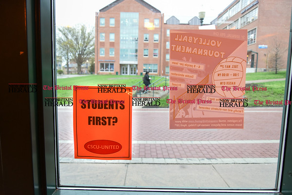 042517 Wesley Bunnell | Staff Facing budget cuts from the State of CT students and faculty organized a protest against CSCU's President Mark Ojakian's budget proposal which they fear would weaken the CCSU campus. A flyers titled Students First? in the 1st floor window of Welte Garage.