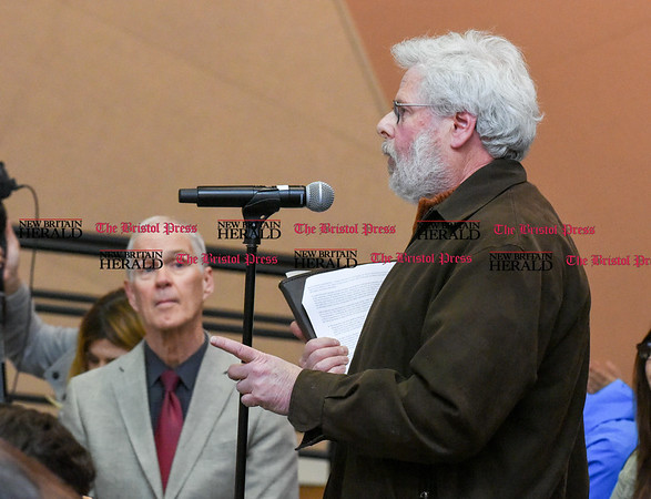 042517 Wesley Bunnell   Staff Facing budget cuts from the State of CT students and faculty organized a protest against CSCU's President Mark Ojakian's budget proposal which they fear would weaken the CCSU campus. Professor David Blitz, right, addresses Mark Ojakian.