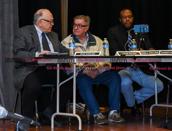 042517 Wesley Bunnell | Staff The New Britain Common Council held its annual public hearing at 7 p.m. Tuesday evening at Smalley Academy regarding Mayor Erin Stewart's proposed budget plan. Aldermen Don Naples, Louis Salvio sit next to Alderman Tremell Collins as he finishes up his Facebook Live stream of the event.