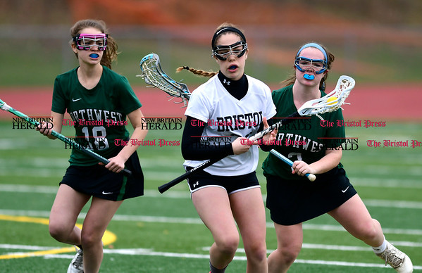 4/26/2017 Mike Orazzi | Staff Bristol Coop Girls Lacrosse's Hannah Ouellette (35) and Northwest Catholic's Gabriela Wolanski (18) and Meghan O'Shea (3) at Bristol Eastern Wednesday.