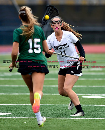 4/26/2017 Mike Orazzi | Staff Bristol Coop Girls Lacrosse Ashley Macdonald (11) and Northwest Catholic's Madison Cote (15) at Bristol Eastern.