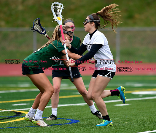 4/26/2017 Mike Orazzi | Staff Bristol lacrosse's Gabriele Abramczyk (8) and Northwest Catholic's Madison Cote (15) at Bristol Eastern.