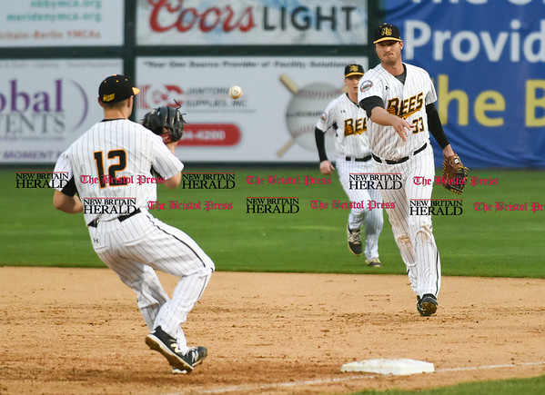 042617 Wesley Bunnell | Staff New Britain Bees vs Lancaster Barnstormers on Wednesday evening. Jon Griffin (33) tosses to Anthony Marzi (12) for the out at first.