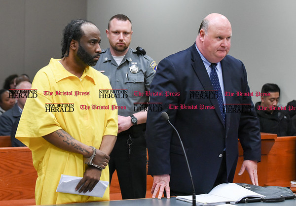 042617 Wesley Bunnell | Staff Patrick Miles stands next to Attorney Robert Pickering as he is arraigned in New Britain Superior Court on Wednesday afternoon for the April 7 murder of his wife Yasheeka. Miles remains jailed in lieu of a $2.5 million bond set by Judge Joan Alexander.