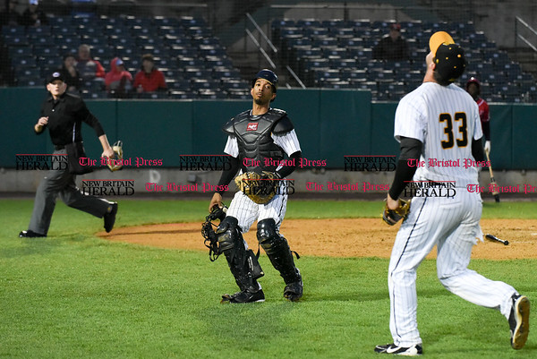 042617 Wesley Bunnell | Staff New Britain Bees vs Lancaster Barnstormers on Wednesday evening. James Skelton (3) watches as Jon Griffin (33) calls him off on a pop up near the Bees bench.