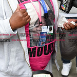 042617  Wesley Bunnell   Staff  Adriene Lauray wears ID badges and a t-shirt with a photo of her daughter Yasheeka Miles outside of New Britain Superior Court on Wednesday afternoon. Yasheek ...