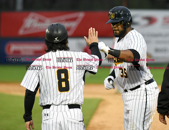 042617 Wesley Bunnell | Staff New Britain Bees vs Lancaster Barnstormers on Wednesday evening. Daisuke Yoshida (8) high fives Jovan Rosa (35) after he Rosa reaches first on a hit.