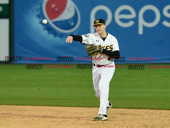 042617 Wesley Bunnell | Staff New Britain Bees vs Lancaster Barnstormers on Wednesday evening. Jake McGuiggan (2) fields and throws to first for the out.