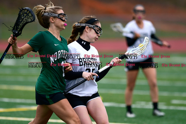 4/26/2017 Mike Orazzi | Staff Bristol Coop Girls Lacrosse's Hannah Ouellette (35) and Northwest Catholic's Madison Cote (15) at Bristol Eastern Wednesday.