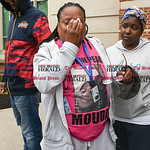 042617  Wesley Bunnell   Staff  Adriene Lauray wipes back tears while wearing ID badges and a t-shirt with a photo of her daughter Yasheeka Miles outside of New Britain Superior Court on Wed ...