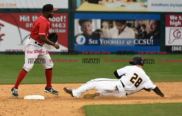 042617 Wesley Bunnell | Staff New Britain Bees vs Lancaster Barnstormers on Wednesday evening. Conor Bierfeldt (28) is forced at second base on a double play.