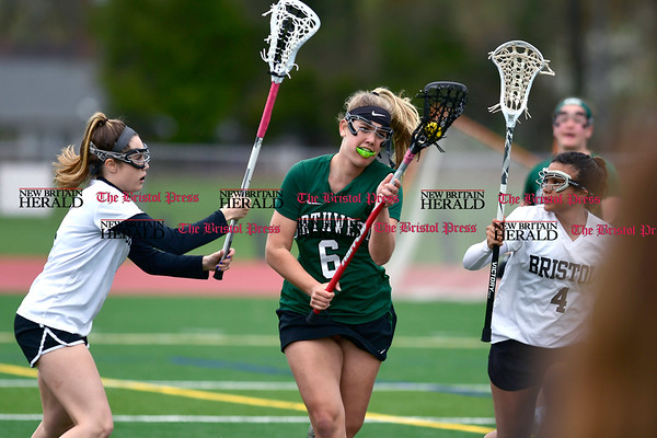 4/26/2017 Mike Orazzi | Staff Bristol lacrosse's Gabriele Abramczyk (8) and Alyson Policarpio (4) with Northwest Catholic's Meredith Oakley (6) at Bristol Eastern.