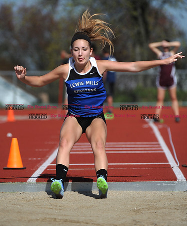 4/28/2017 Mike Orazzi | Staff Lewis Mills' Alycia Fournier in the long jump during the Bristol Central Invitational Track Meet in Bristol Friday.