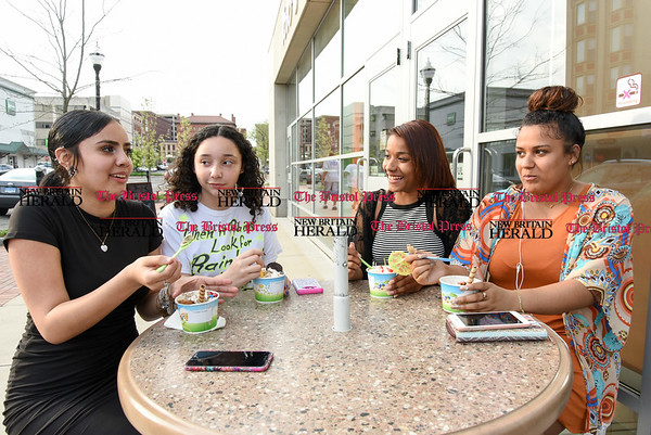 042817 Wesley Bunnell | Staff Friends Genesis Medina, Ana Colon, Kiana Dingle & Yaidelis Cartagena sit on Main St on Friday afternoon enjoying their ice cream from newly opened Yo Yo Ice Cream.
