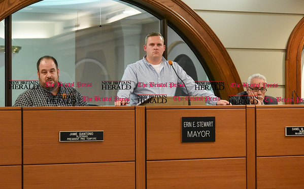 040517 Wesley Bunnell | Staff The New Britain Committee of Administration, Finance and Law voted to table a resolution regarding salary adjustments for elected and appointed officials on Wednesday evening. Aldermen Jaime Giantonio, left, Robert Smedley and Daniel Salerno.
