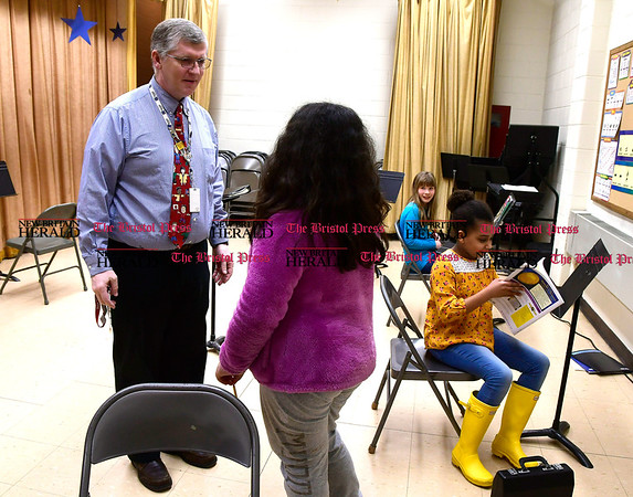 4/6/2017 Mike Orazzi | Staff Ken Bagley, citywide coordinator for music director, talks with South Side School 4th grade student Alison Sarmiento Thursday afternoon.