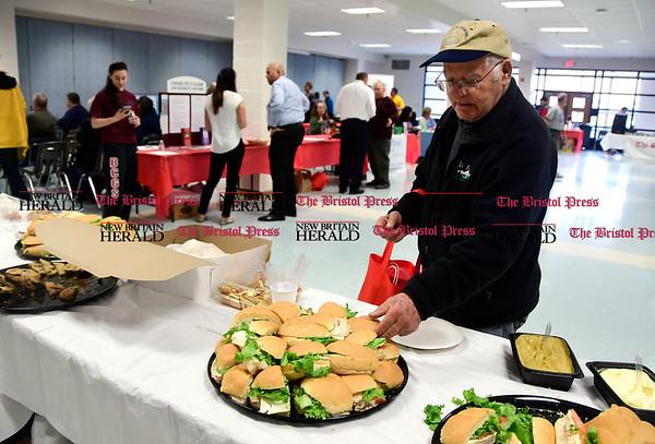 4/7/2017 Mike Orazzi | Staff Leo Bonola grabs a free sandwich during The Bristol Press & New Britain Herald and Connecticut Prime Time's 3rd Annual Senior Fair held at Bristol Eastern High School Saturday.