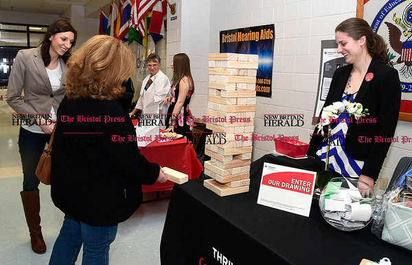 4/7/2017 Mike Orazzi | Staff Joanne Davis (center) with Thrivent Financial's Julia Weston and Stephanie Fritz during The Bristol Press & New Britain Herald and Connecticut Prime Time's 3rd Annual Senior Fair held at Bristol Eastern High School Saturday.