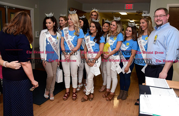 4/8/2017 Mike Orazzi | Staff Miss Connecticut hopefuls talk with a resident while visiting Countryside Manor Saturday morning in Bristol. The group was there as part of Miss Connecticut Alyssa Rae Taglia' &quote;Smiles for Seniors&quote; program.