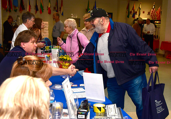 4/7/2017 Mike Orazzi | Staff Bob Badal shakes hands with Bristol Hospitals' Chris Boyle (seated) during The Bristol Press & New Britain Herald and Connecticut Prime Time's 3rd Annual Senior Fair held at Bristol Eastern High School Saturday.