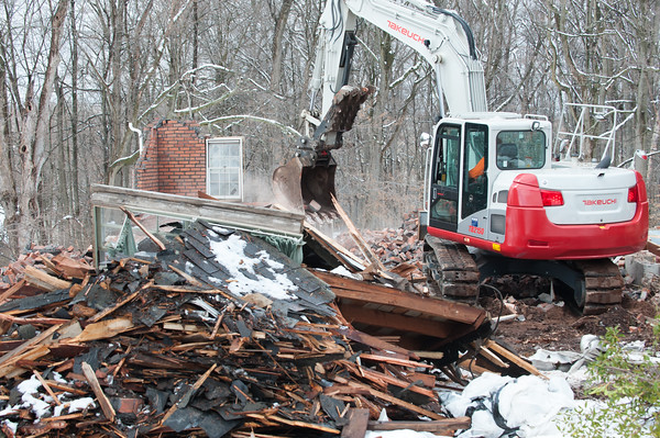 04/02/18 Wesley Bunnell | Staff Demolition of a house adjacent to Kensington Congregational Church started on Monday which is the first step in an expansion to the church property. The remnants of a the garage with only a single standing window and corner remain.