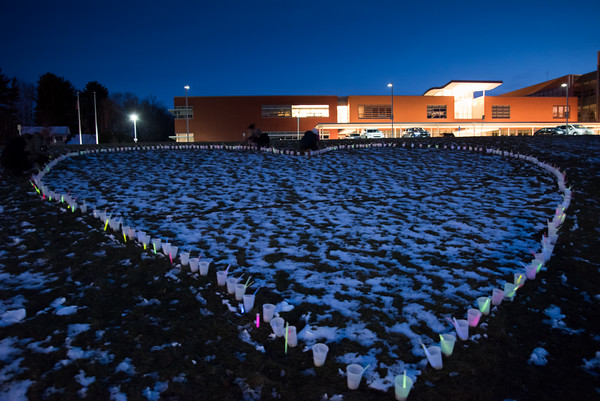 04/02/18 Wesley Bunnell | Staff Luminaries were placed in front of Greene-Hills School Monday night in honor of third grade teacher Stacey Clingan. Two of Stacey Clingan's students, Amelia Daliga and Riley Bashaw are shown silhouetted against the building at the top of the heart.