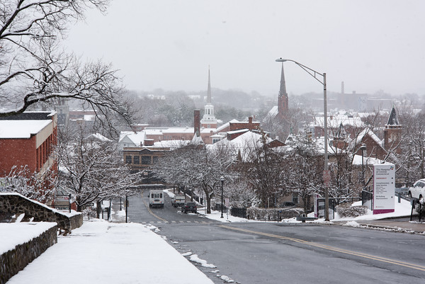 04/02/18 Wesley Bunnell | Staff Snow blankets trees and buildings looking down Grand St in New Britain on Monday afternoon.