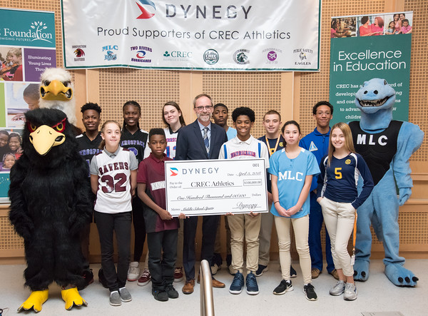 04/03/18 Wesley Bunnell | Staff Representatives from Dynegy, a power generating company in the Northeast, MId-Atlantic, Midwest and Texas, presented a $100,000 donation to CREC Athletics. The donation will be used towards the continuation of middle school sports at five participating CREC schools for the upcoming year. Vice President of Dynegy Plant Operations Peter Ziegler, middle, stands with a ceremonial check surrounded by middle school athletes and mascots benefitting from the donation.