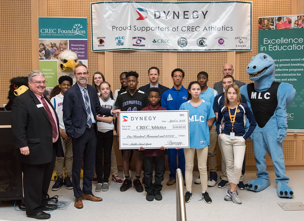 04/03/18 Wesley Bunnell | Staff Representatives from Dynegy, a power generating company in the Northeast, MId-Atlantic, Midwest and Texas, presented a $100,000 donation to CREC Athletics. The donation will be used towards the continuation of middle school sports at five participating CREC schools for the upcoming year. CREC Superintendent Tim Sullivan, far L, stands next to Vice President of Dynegy Plant Operations Peter Ziegler during the ceremonial check presentation as they are flanked by middle school athletes benefitting from the donation.