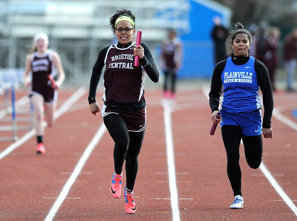 4/5/2018 Mike Orazzi | Staff Bristol Central's Shy-Ann Whitten in the 4x100 relay at Plainville High School Thursday afternoon.