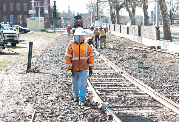 04/05/18 Wesley Bunnell | Staff Pan-Am crews are on the scene of a train derailment on Thursday morning in front of Columbus Plaza assessing and making repairs to the tracks. The site was also the scene of a derailment in 2016. A worker walks the tracks looking for broken wooden railroad ties underneath the tracks.