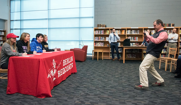 04/05/18 Wesley Bunnell | Staff Berlin Athletic Director Jeff Mauri takes a photo of Berlin High School student athletes who just signed their letters of intent to play college sports. Lexi Kavarsky, L, committed to Sacred Heart, Julia Sisti committed to Stonehill, Noah Silverman to CCSU and Nikki Xiarhos to Bryant.