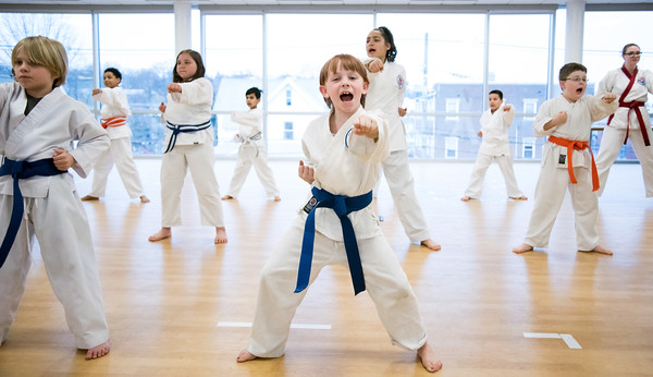 04/09/18 Wesley Bunnell | Staff The Martial Arts Program at the Bristol Boys and Girls Club for ages 7 and up meets every Monday at 5:45. Annie Hayman, age 8, middle, practices middle punch from a horse stance.