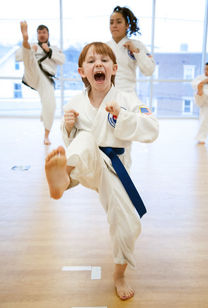 04/09/18 Wesley Bunnell | Staff The Martial Arts Program at the Bristol Boys and Girls Club for ages 7 and up meets every Monday at 5:45. Annie Hayman, age 8, practices her front kick.