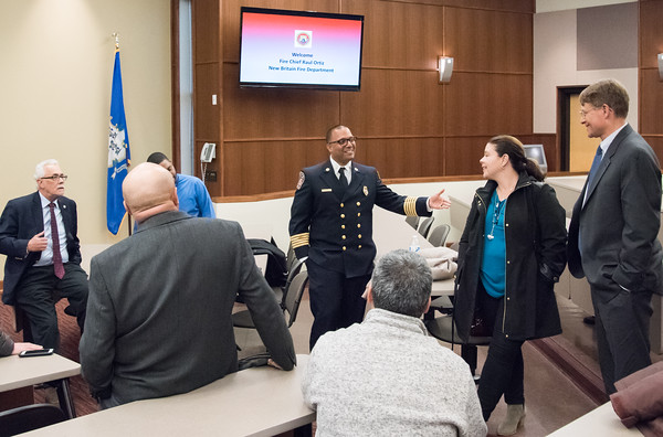 04/11/18 Wesley Bunnell | Staff New Fire Chief Raul Ortiz held an open session to meet the public from 5-7pm at the New Britain High School lecture hall on Monday. Chief Ortiz greets visitors as they enter the lecture hall.