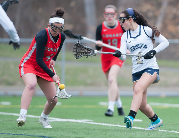 04/17/18 Wesley Bunnell | Staff Newington girls lacrosse was defeated 19-2 by Conard at Newington on Tuesday afternoon. Maddy Mangiafico (2).