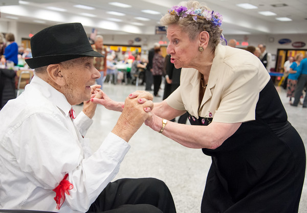 04/19/18 Wesley Bunnell | Staff WWII Veteran George Goldfuss dances with Mary Lou Cunningham on Thursday night at TRIAD's 20th annual senior prom held at New Britain High School which featured a carnival theme. Cunningham and Goldfuss would be named co king and queen of the prom.
