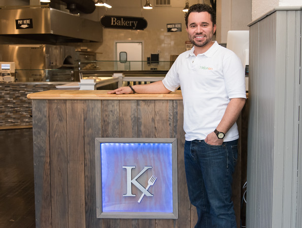 04/19/18 Wesley Bunnell | Staff Mofongo owner Vincent Placeres is set to open a new restaurant named The Kitchen which located at 136 Main St. Vincent Placeres poses for a photo next to the hostess station.