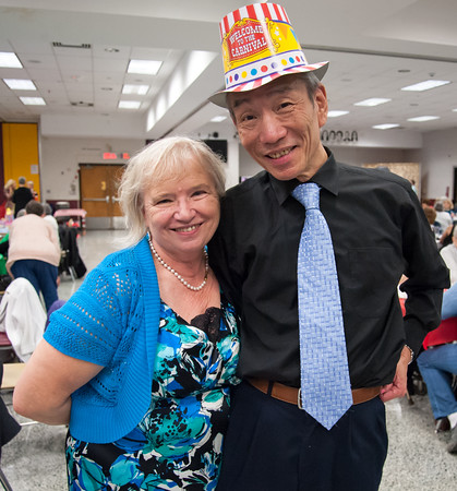 04/19/18 Wesley Bunnell | Staff Mary Lacic takes a break from dancing to pose with Henry Ye on Thursday night at TRIAD's 20th annual senior prom held at New Britain High School which featured a carnival theme.