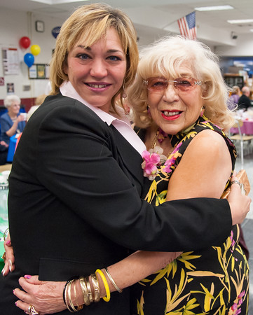 04/19/18 Wesley Bunnell | Staff Jennifer Ryan from New Britain Memorial-Sagarino Funeral Home poses for a photo with Peg Mottola Thursday night at TRIAD's 20th annual senior prom held at New Britain High School which featured a carnival theme.