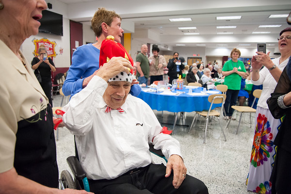 04/19/18 Wesley Bunnell | Staff WWII Veteran George Goldfuss wears the kings crown Thursday night at TRIAD's 20th annual senior prom held at New Britain High School which featured a carnival theme. Cunningham was named co king of the prom.