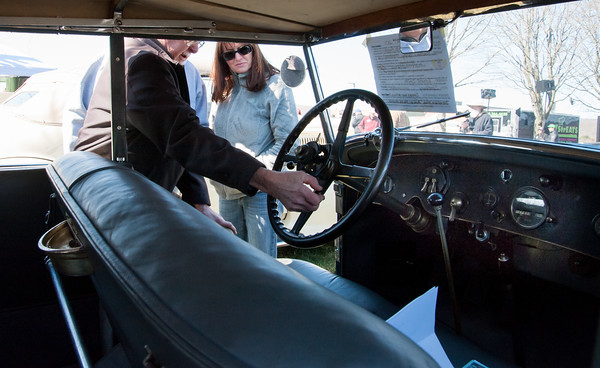 04/21/18 Wesley Bunnell | Staff 1927 Rolls Royce Phantom I owner Ernest Smith of Simsbury explains the controls to visitor Alina Reut and Jeffrey Reut at the Klingberg Family Center. The Klingberg Vintage Motorcar Series held their April event on Saturday with a focus on the Ford Model A.