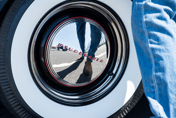 04/21/18 Wesley Bunnell | Staff The reflection of the owner Bruce Richard of Harwinton is shown in the hubcap of a 1941 Studebaker Commander parked at the Klingberg Family Center. The Klingberg Vintage Motorcar Series held their April event on Saturday with a focus on the Ford Model A.
