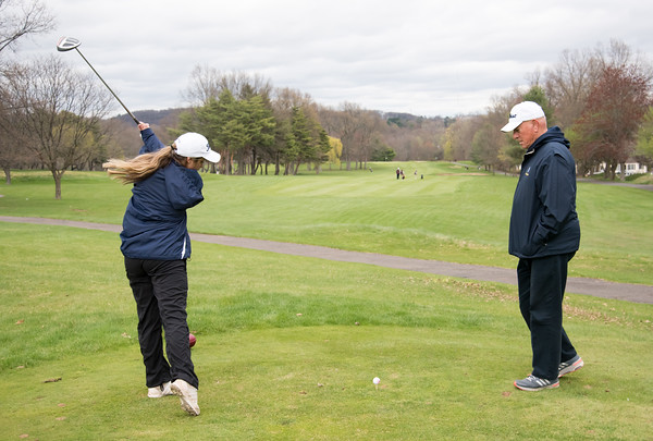 04/30/18 Wesley Bunnell | Staff Newington girls golf vs New Britain on Monday afternoon at Indian Hill Golf Club in Newington. Newington's Tori Tolisano receives instruction from coach Rich Condon.