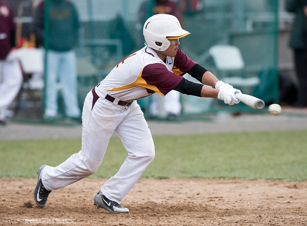 04/11/18 Wesley Bunnell | Staff New Britain baseball was defeated by Bristol Eastern on Wednesday afternoon at Beehive Field. Francisco Alvarado (4) with a bunt attempt.