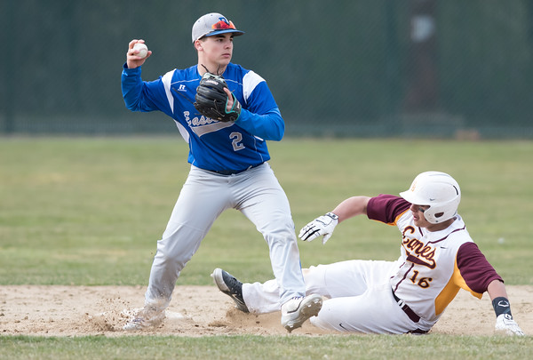 04/11/18 Wesley Bunnell | Staff New Britain baseball was defeated by Bristol Eastern on Wednesday afternoon at Beehive Field. Ruffino Santiago (16) slides into 2nd but was forced on the play by Matt D'Amato (2).