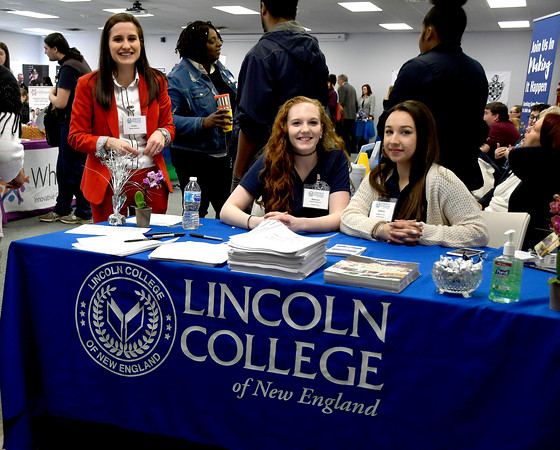 4/12/2018 Mike Orazzi | Staff Lincoln College's Jenifer Rahusen, Shannon Warner and Amanda Rodriguez during the Lincoln College Career Fair held on campus Thursday.